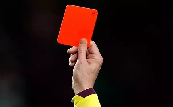 Soccer referee holding a red card