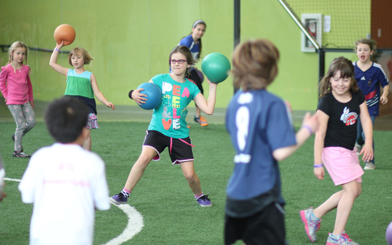 Camp girl throwing dodgeball