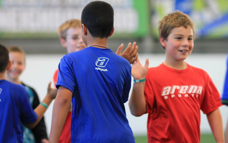 Boys Youth Leagues soccer players high-five