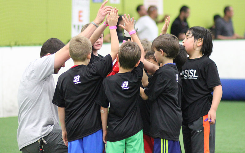 Team huddle in Skills Institute Soccer League